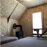 Intérieur des prêts-à-camper/glamping nommés tentes boréales disponibles à la location au Camping du Domaine Lausanne